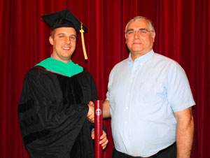 Dr. Bryce Christropherson is congratulated by his father Dr. Terry Christopherson